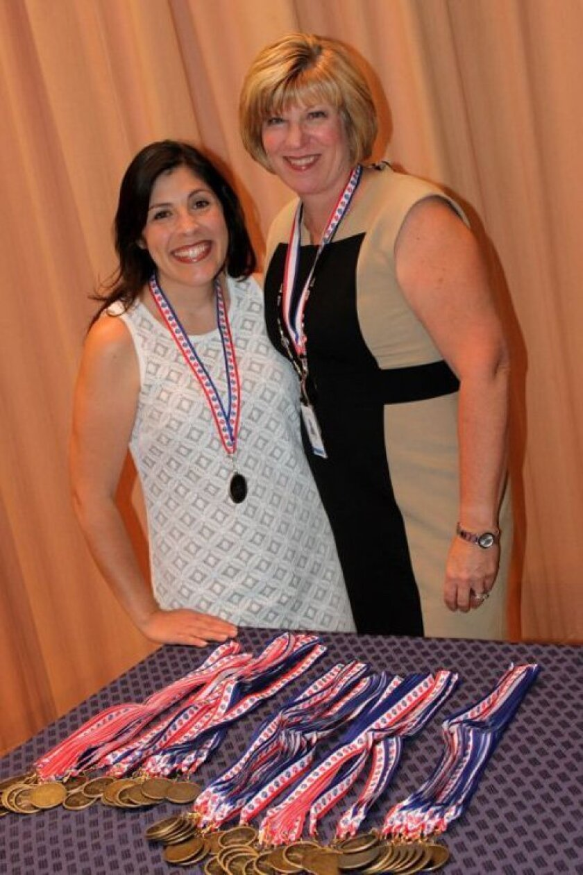 Curriculum Resource Teacher Veronica Reist, who coordinated the Books and Beyond program, and Principal Julie Norby.