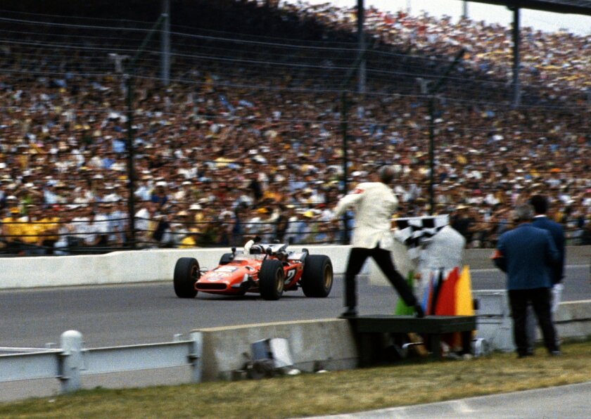 """In this May 30, 1969 photo provided by Indianapolis Motor Speedway, Mario Andretti takes the checkered flag as he wins the 53rd running of the Indianapolis 500 auto race at Indianapolis Motor Speedway in Indianapolis, Ind. In the lead-up to the 100th running of the """"The Greatest Spectacle in Racing,"""" The Associated Press interviewed the 27 living race winners on topics ranging from the best driver to greatest tradition. """"No question, there's nothing that can match seeing the checkered flag,"""" said 1969 winner Mario Andretti. (IMS via AP)"""