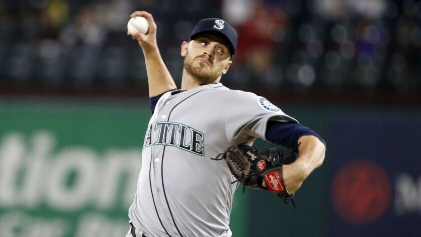 Seattle Mariners relief pitcher Justin Grimm (57) pitches against the Texas Rangers during the ninth