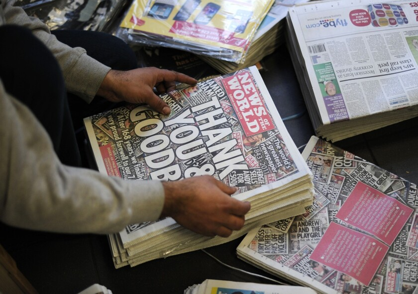 The U.S. Department of Justice has declined to bring charges after its investigation into whether News Corp. violated U.S. laws in the 2011 phone hacking scandal. Rupert Murdoch's company shuttered its British tabloid newspaper News of the World in 2011, pictured here.