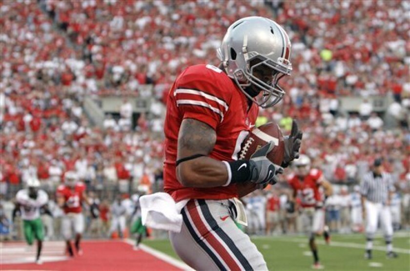 Ohio State's DeVier Posey catches a touchdown pass against Marshall during the first quarter of an NCAA college football game, Thursday, Sept. 2, 2010, in Columbus, Ohio. (AP Photo/Jay LaPrete)
