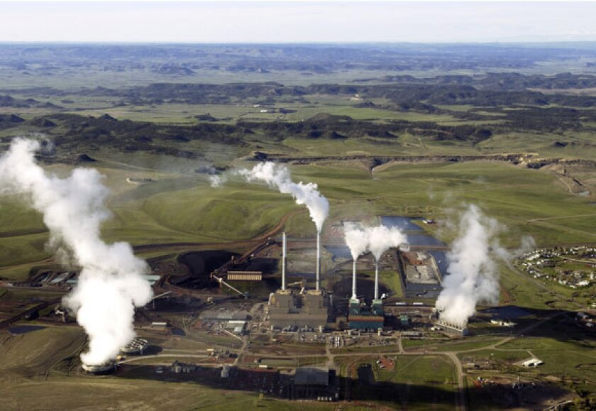 The power plants of Colstrip, Mont., in a 2003 photo. Activists are pressuring Puget Sound Energy to stop buying electricity from the coal-fired plants.