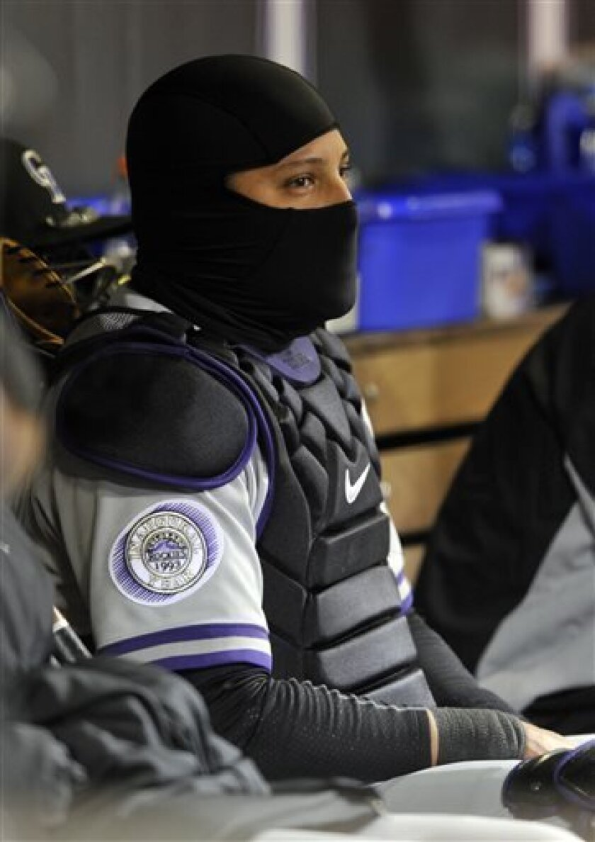 Colorado Rockies catcher Yorvit Torrealba looks on from the dugout against the New York Mets during the fifth inning in the second baseball game of a doubleheader Tuesday, April 16, 2013, in Denver. (AP Photo/Jack Dempsey)