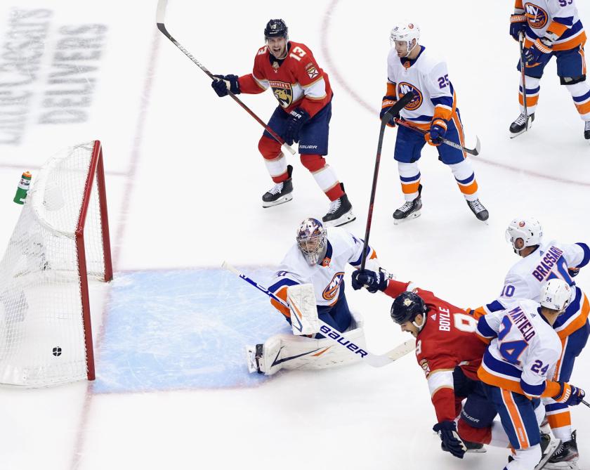 Florida Panthers' Brian Boyle scores against New York Islanders goalie Semyon Varlamov