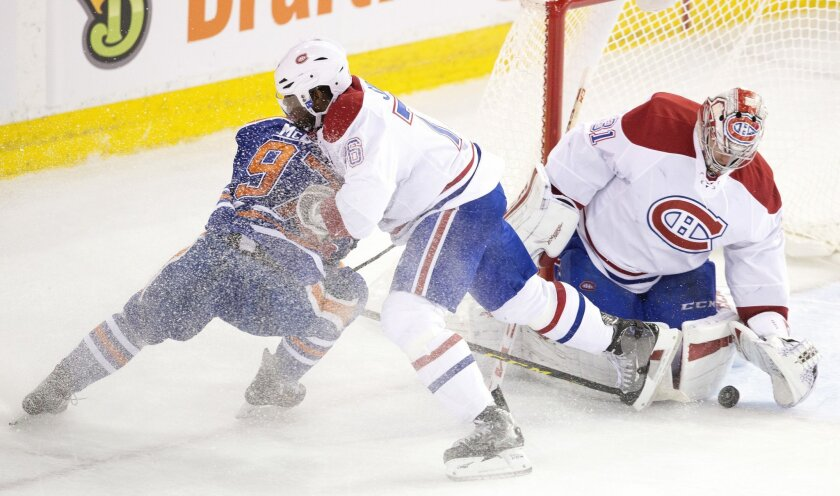 Montreal Canadiens' P.K. Subban (76) defends against Edmonton Oilers' Connor McDavid (97) as goalie Carey Price (31) makes the save during second period NHL action in Edmonton, Alberta, on Thursday, Oct. 29, 2015. (Jason Franson/The Canadian Press via AP)