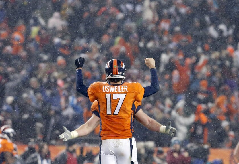 Denver Broncos quarterback Brock Osweiler (17) celebrates the game winning touchdown during overtime of an NFL football game against the New England Patriots, Sunday, Nov. 29, 2015, in Denver. The Broncos defeated the Patriots 30-24. (AP Photo/Joe Mahoney)