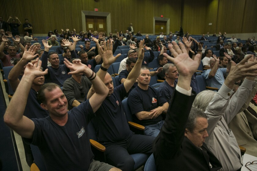 Los Angeles County firefighers express their concerns about cell towers at fire stations during a meeting of the Board of Supervisors.
