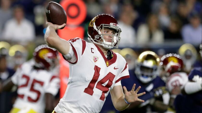 USC quarterback Sam Darnold throws during an NCAA football game against Notre Dame. Darnold is expected to be a high pick in the first round in the NFL Draft.