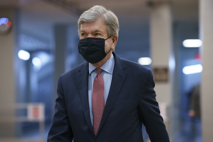 A closeup of Roy Blunt, wearing a mask.