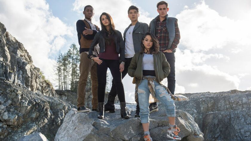 The new Power Rangers: RJ Cyler as Billy, left, Naomi Scott as Kimberly, Ludi Lin as Zack, Becky G as Trini and Dacre Montgomery as Jason.