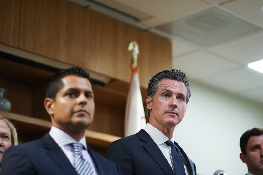 Gov. Gavin Newsom takes questions during a press conference at Public Counsel, on Wednesday in Los Angeles
