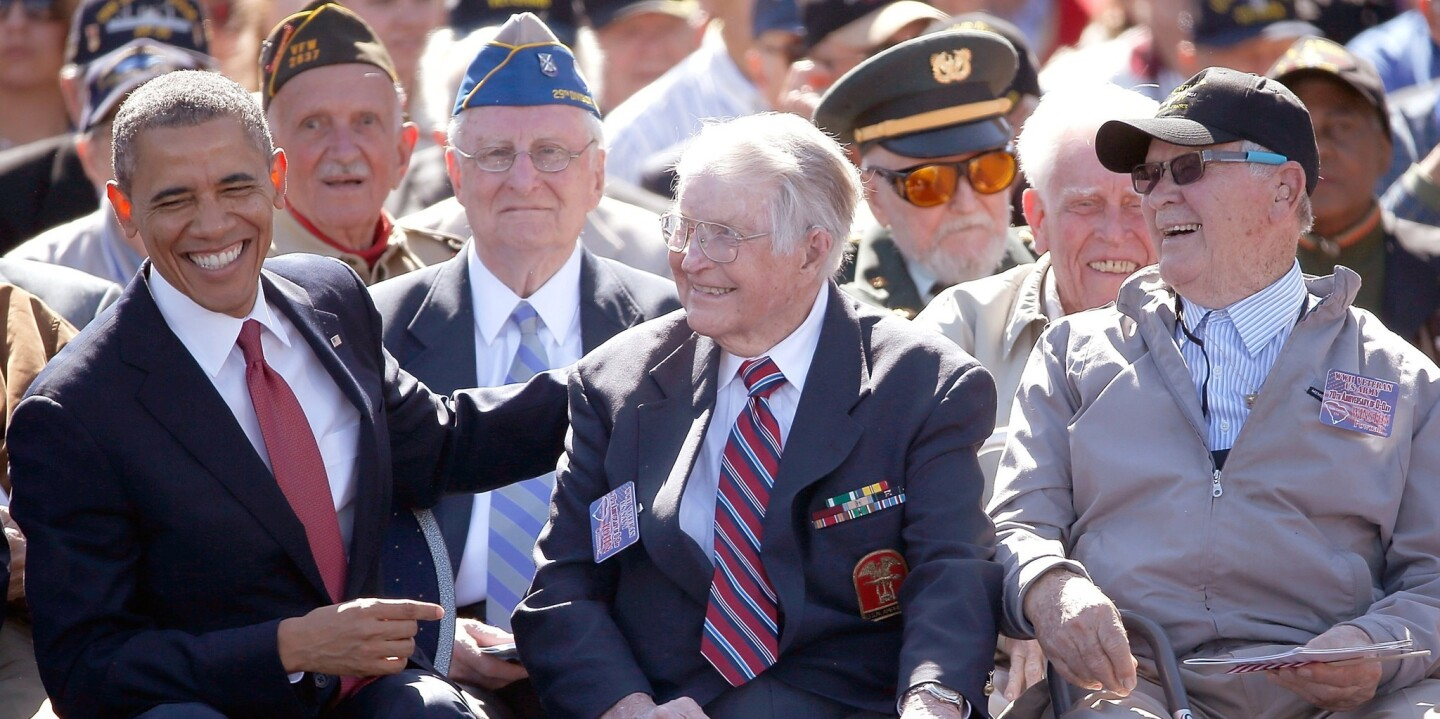 President Obama greets WWII veterans at the Normandy American Cemetery on the 70th anniversary of D-Day.