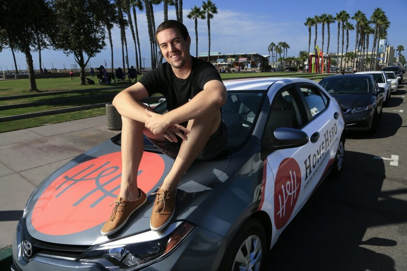 Calder Pearce shows off his Toyota Corolla, which has been wrapped with a laminate ad. Pearce figures he earns monthly more than enough to pay for his car, car insurance and cell phone with left over cash to spare. His car ad is a 3-month ad campaign and he hopes to be eligible for another ad campaign.