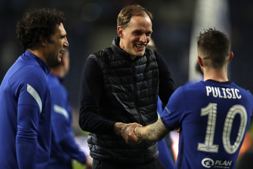 Chelsea's head coach Thomas Tuchel, center, celebrates with Chelsea's Christian Pulisic after winning the Champions League final soccer match between Manchester City and Chelsea at the Dragao Stadium in Porto, Portugal, Saturday, May 29, 2021. (AP Photo/Manu Fernandez, Pool)