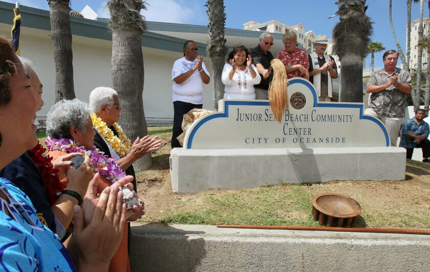 Annual Oceanside Samoan Cultural Celebration at the Pier Amphitheatre- The concrete monument to the Junior Seau Beach Community Center is unveiled by Oceanside City officials. With hat is Mayor Jim Wood. At left are Junior's parents Luisa and Tiaina Seau and at close left is Junior's sister Annette