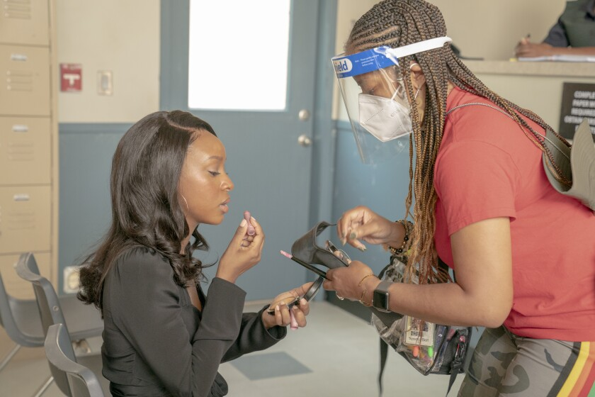 """Actress Ebony Obsidian and makeup artist Syretta Bell work behind the scenes on the Tyler Perry show """"Sistas."""""""