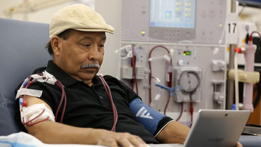 Patient Adrian Perez undergoes dialysis at a DaVita clinic in Sacramento. The company spent lavishly on a successful campaign to kill a ballot measure that would have capped its California revenue.
