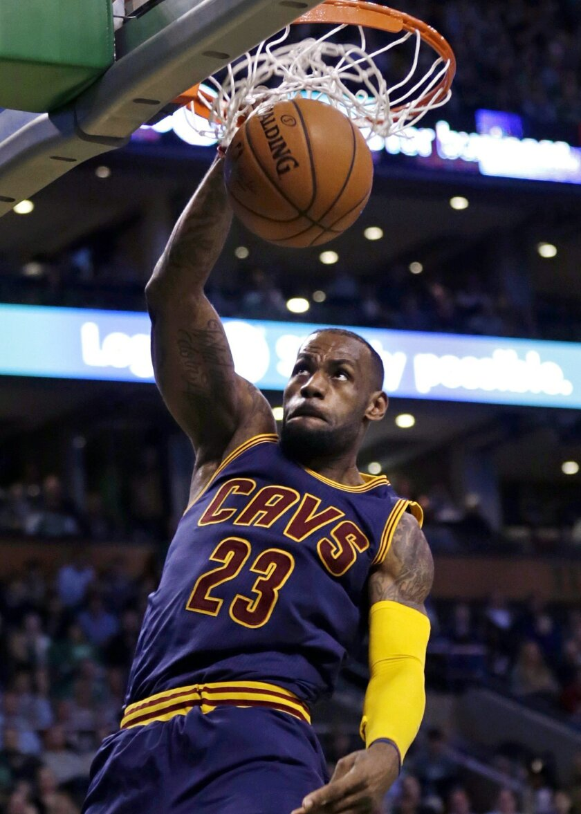 Cleveland Cavaliers forward LeBron James slams a dunk against the Boston Celtics during the second half of a first-round NBA playoff basketball game in Boston, Thursday, April 23, 2015. James had 31 points as the Cavaliers defeated the Celtics 103-95, taking a 3-0 lead in the series. (AP Photo/Char