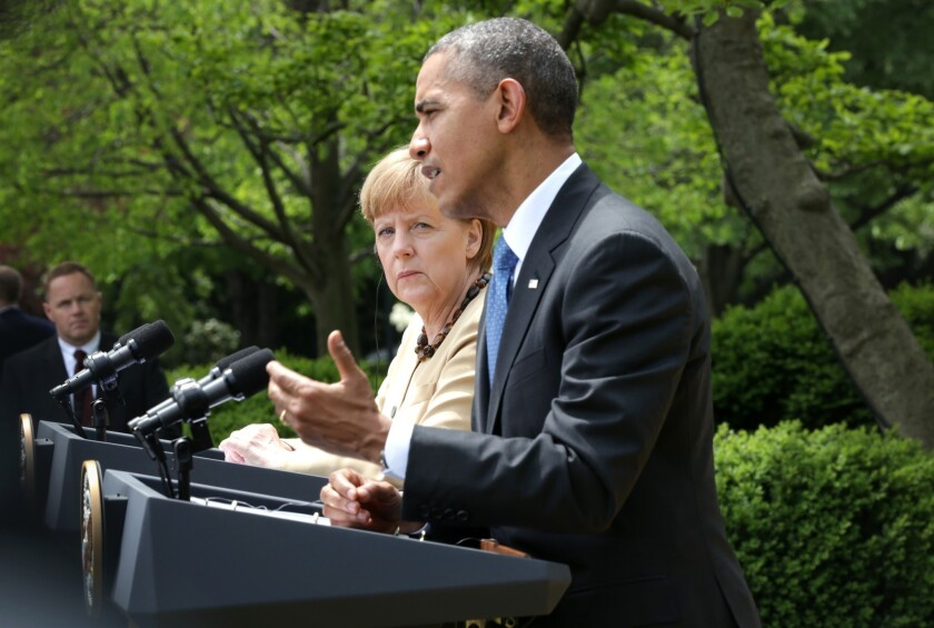President Obama and German Chancellor Angela Merkel hold a joint news conference in the Rose Garden at the White House.