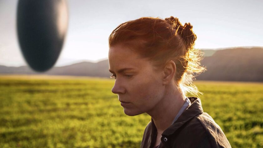 """""""Arrival's"""" hovering, vertical spaceship and star Amy Adams."""