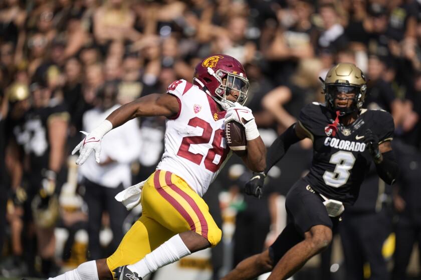 USC's Keaontay Ingram runs on the field.