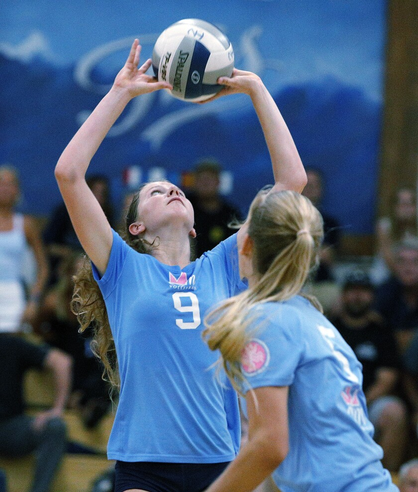 Corona del Mar's Bella Pouliot, shown setting the ball at Newport Harbor on Sept. 12, helped the Sea Kings finish as undefeated Surf League champions on Tuesday.