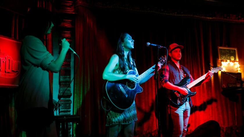 Jenny Skiffington, left, Laura Brunkala and Dustin Green from the band Broken Arrows, perform at The Other Door,