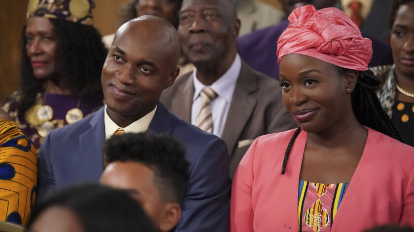 "Tony Tambi and Folake Olowofoyeku in ""Bob Hearts Abishola"" on CBS"