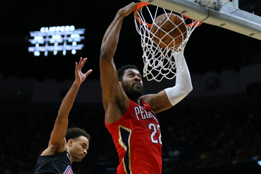 New Orleans' Derrick Favors dunks against the Clippers on Jan. 18.
