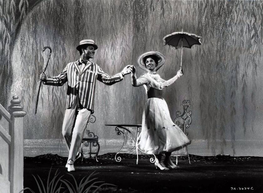 "Dick Van Dyke as Bert and Julie Andrews as the titular nanny dance in ""Mary Poppins."""