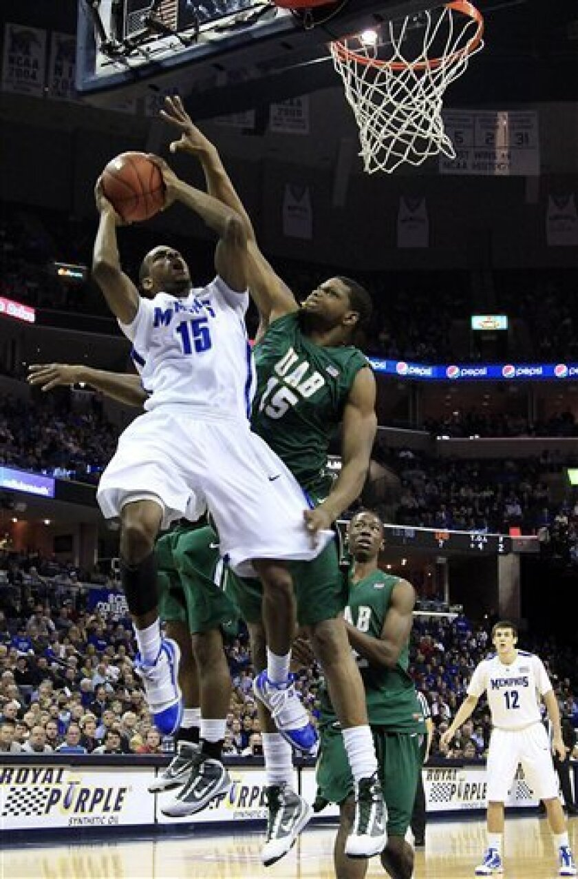 Memphis guard Elliot Williams, left, goes to the basket against UAB center Kenneth Cooper (15) during the first half of an NCAA college basketball game in Memphis, Tenn., Wednesday, Feb. 3, 2010. (AP Photo/Lance Murphey)