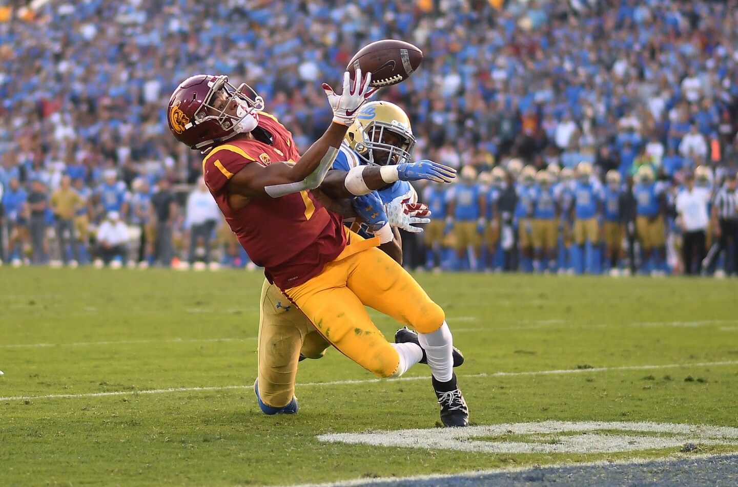 USC receiver Velus Jones Jr. can't make the catch near the end zone as Bruins defensive back Adarius Pickett defends late in the fourth quarter Saturday at the Rose Bowl.