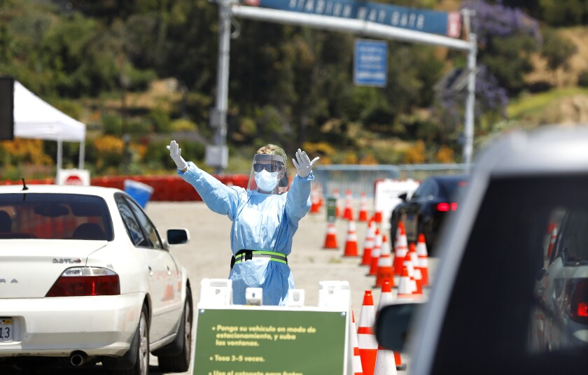 The drive-through coronavirus testing center at Dodger Stadium is the largest in L.A. County.