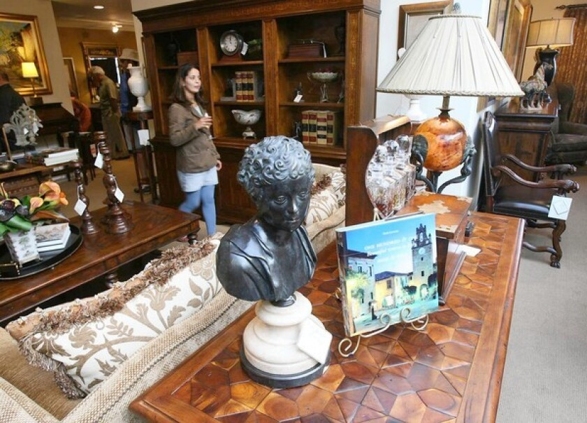 Living room furnishings are displayed at Von Hemert Interiors, which is closing after 99 years. The company has locations in Costa Mesa and Torrance.