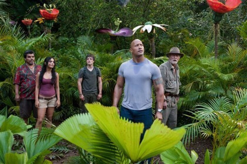 "In this image released by Warner Bros. Pictures, from left,  Luis Guzman, Vanessa Hudgens, Josh Hutcherson, Dwayne Johnson and Michael Caine are shown in a scene from ""Journey 2: The Mysterious Island."" (AP Photo/Warner Bros. Pictures, Ron Phillips)"