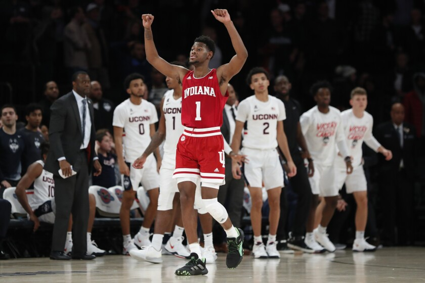FILE - Indiana guard Al Durham (1) celebrates at the end of an NCAA college basketball game against Connecticut in the Jimmy V Classic in New York, in this Wednesday, Dec. 11, 2019, file photo. Durham was Indiana's most consistent 3-point shooter last season. (AP Photo/Kathy Willens, File)