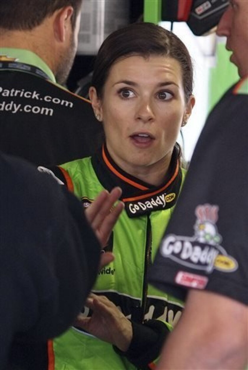 Driver Danica Patrick talks to her crew during practice for Sunday's Sprit Cup series auto race at Martinsville Speedway in Martinsville, Va., Saturday, April 6, 2013. (AP Photo/Steve Sheppard)
