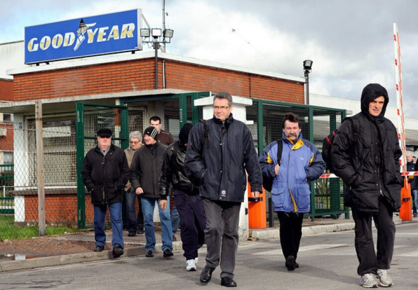 Workers leave a Goodyear tire plant in Amiens, France.
