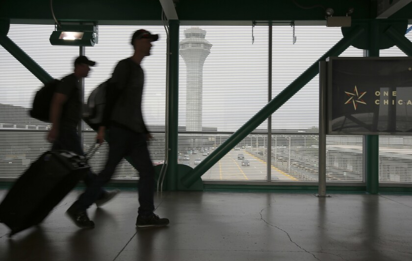 Travelers walk through Terminal 3 at Chicago's O'Hare International Airport on June 30, 2017.