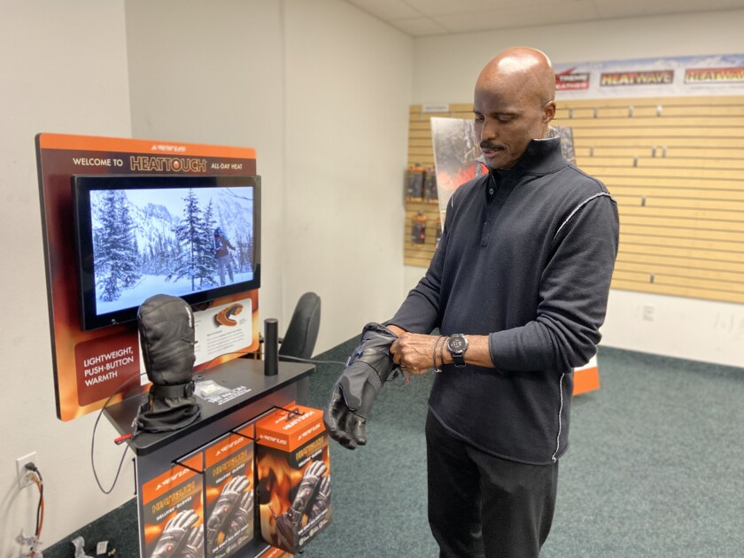 Mike Carey, a former NFL referee, shows products from his apparel company Seirus