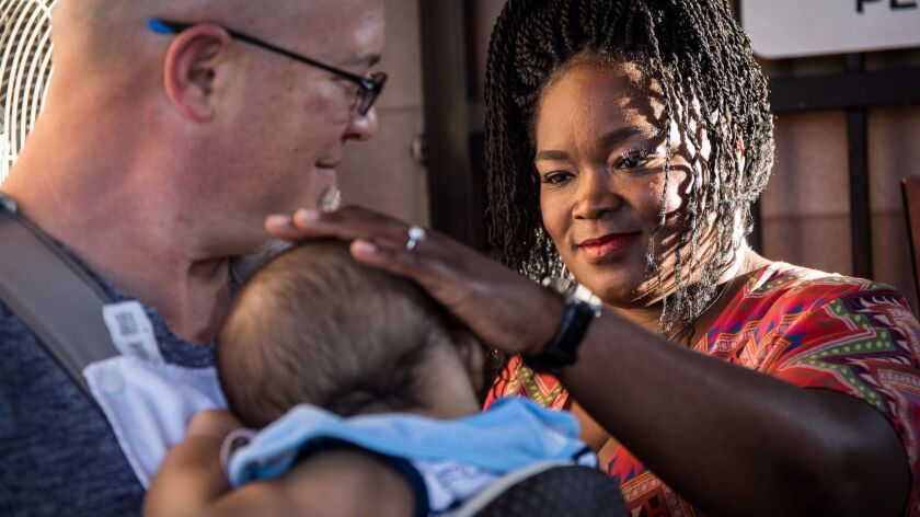 Chicago blues singer Shemekia Copeland visits with her son held by Brian Schultz seconds before taki