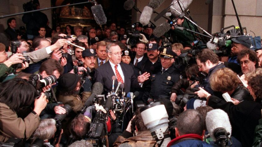 Kennetth Starr is swarmed by the media in 1998 while investigating President Bill Clinton, a scene that hasn't been repeated by special counsel Robert S. Mueller III.