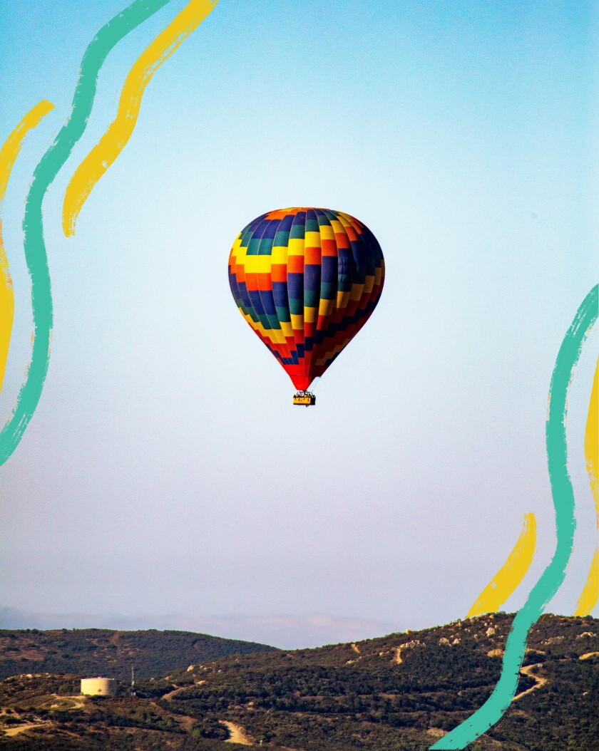 Photograph of a hot-air balloon floating over the Temecula Valley with illustrated lines.