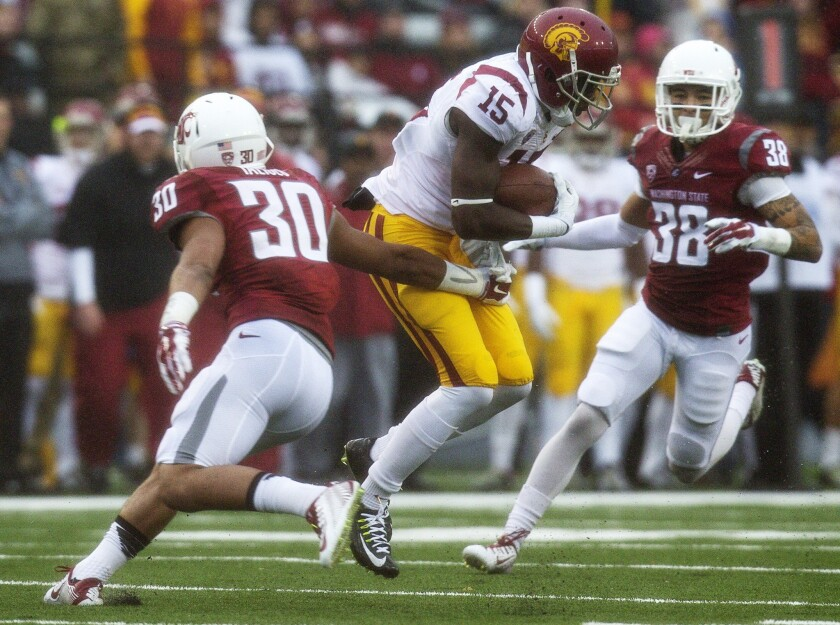 USC's Nelson Agholor, shown breaking a tackle attempt by Washington State's Taylor Taliulu, caught eight passes for 220 yards, including an 87-yard touchdown reception, with a 65-yard punt return for a touchdown as well.