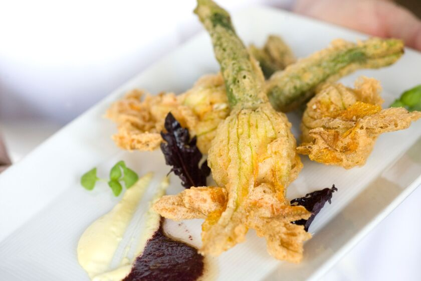 The stuffed squash blossoms at Cucina are among the most deliciously delicate appetizers in town.