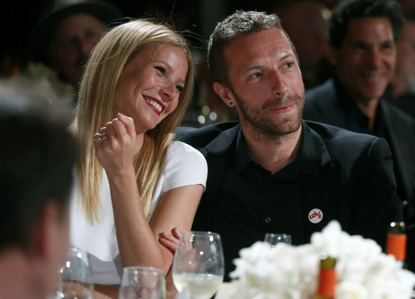 The couple, conscious: Actress Gwyneth Paltrow, left, and her now-estranged husband, singer Chris Martin, at the 3rd Annual Sean Penn & Friends Help Haiti Home Gala in Beverly Hills, Calif.