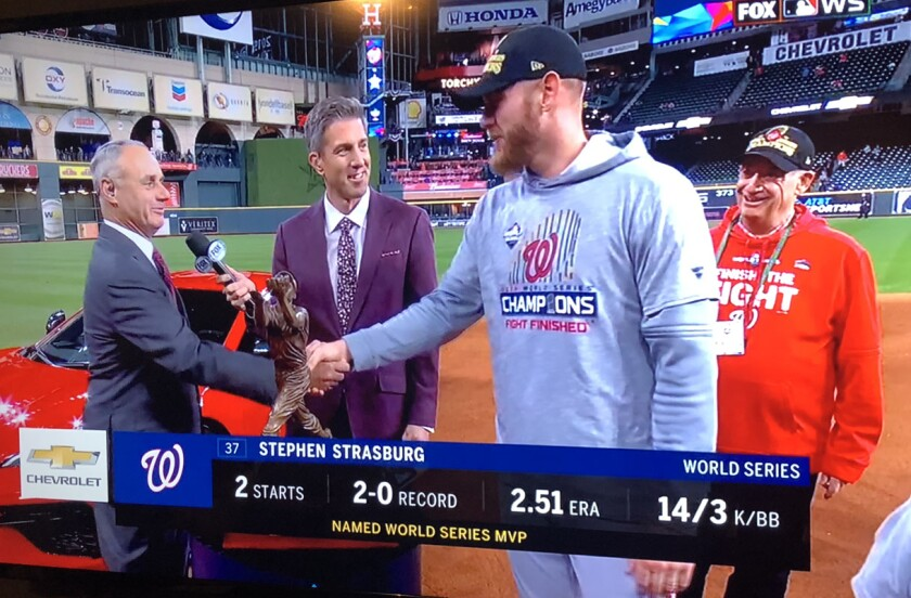Washington Nationals pitcher Stephen Strasburg shakes hands with MLB Commissioner Rob Manfred after being named 2019 World Series MVP on Wednesday night after the Natonals' 6-2 Game 7 win over Houston.