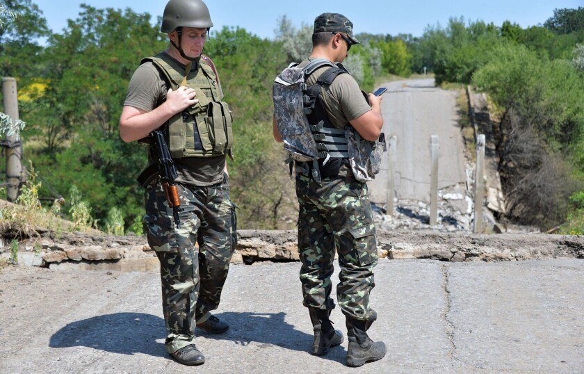 Ukrainian service at a bridge destroyed by pro-Russia militants in the village of Zolotarevka, near the eastern Ukrainian city of Lysychansk, in the region of Lugansk, on July 25, 2014.