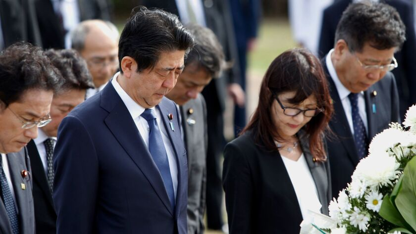 Japanese Prime Minister Shinzo Abe, second from left, at the Ehime Maru Memorial at Kakaako Waterfront Park on Monday in Honolulu.