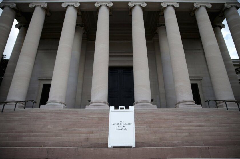A sign alerting visitors that the National Gallery of Art in Washington is closed on Tuesday morning.